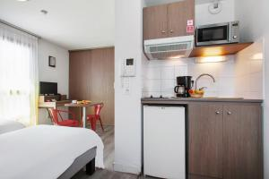 A kitchen or kitchenette at Appart'City Marseille Euromed