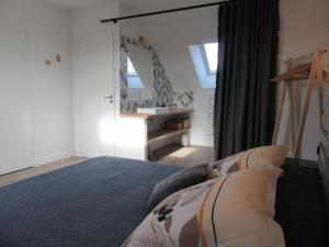 A bed or beds in a room at Les Bordes