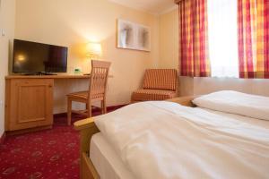 Ein Bett oder Betten in einem Zimmer der Unterkunft Wirtshaus Restaurant Pension Steirerland