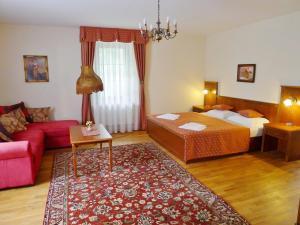 Letto o letti in una camera di Hotel Nosal