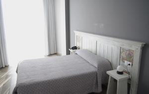 Cama o camas de una habitación en Hotel Mica