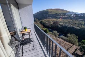 Uma varanda ou terraço em Casa Foz do Corgo - Moderna