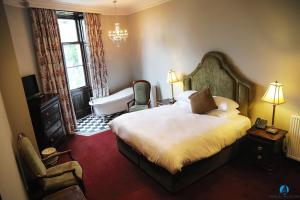 A bed or beds in a room at Markree Castle