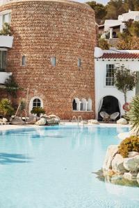 Het zwembad bij of vlak bij Hacienda Na Xamena, Ibiza
