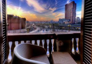 A balcony or terrace at Tahrir Plaza Suites - Museum View
