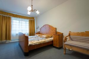 A bed or beds in a room at Maldis
