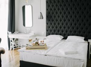Кровать или кровати в номере Отель Усадьба