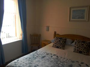 A bed or beds in a room at Eden House