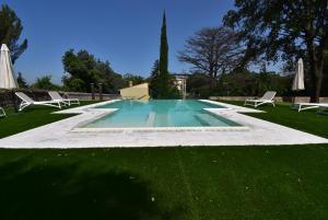The swimming pool at or near Park Hotel Villa Grazioli
