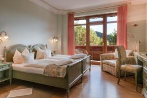 Ein Bett oder Betten in einem Zimmer der Unterkunft Landhaus Sonnenhof