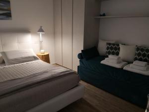 Letto o letti in una camera di B&B Le Farfalle