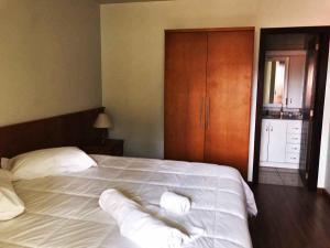 Cama ou camas em um quarto em Sobrados Muller