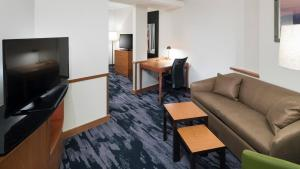A television and/or entertainment center at Fairfield Inn Suites by Marriott Orlando At SeaWorld