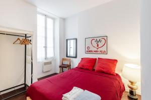 A bed or beds in a room at LA JOLIETTE- Spacieux et lumineux, 4 couchages