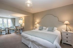A bed or beds in a room at Heacham Manor Hotel