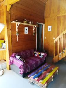 Un ou plusieurs lits dans un hébergement de l'établissement Les chalets de la forêt d'Issaux