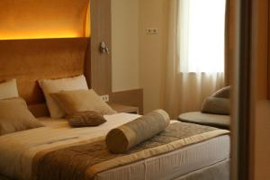 A bed or beds in a room at Spa Hotel Terme