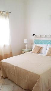 A bed or beds in a room at Casa Bithia