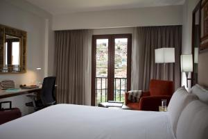 A bed or beds in a room at Hilton Garden Inn Cusco