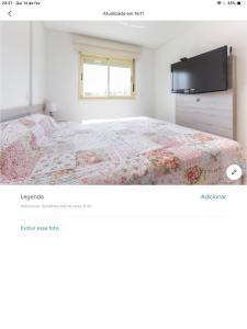 A bed or beds in a room at Cobertura Aischa Hum