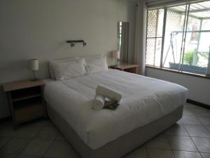 A bed or beds in a room at Margaret House