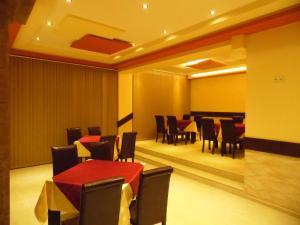 Ресторант или друго място за хранене в Hotel Amigos