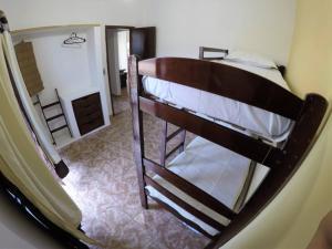 A bunk bed or bunk beds in a room at Praia Linda Hospedagem