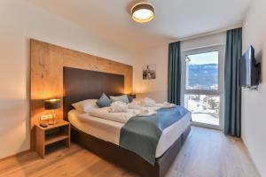 Postel nebo postele na pokoji v ubytování Lake Resort Pressegger See