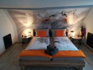 Ein Bett oder Betten in einem Zimmer der Unterkunft Ferienhaus Alida