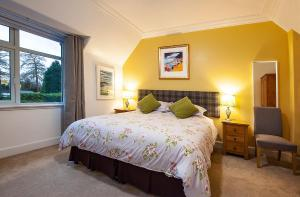 A bed or beds in a room at Clune House