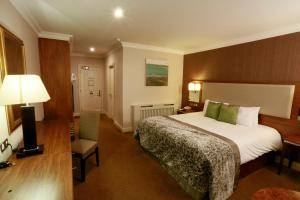 A bed or beds in a room at Vaughan Lodge Hotel