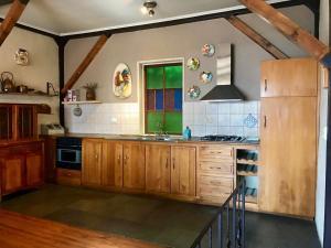 Una cocina o zona de cocina en Casa porteña en cerro Artilleria