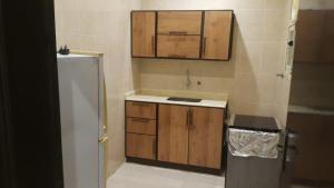 A cozinha ou cozinha compacta de Al Eairy Apartments - Jazan 3