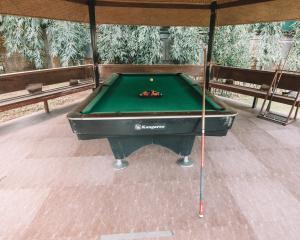 A pool table at El Nido Garden Resort
