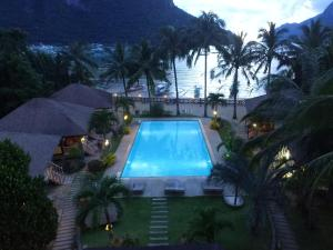 A view of the pool at El Nido Garden Resort or nearby