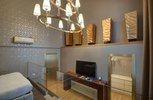 A television and/or entertainment center at Penthouse Suite Rome