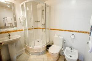 Ванная комната в Отель Яхт Клуб Новый Берег
