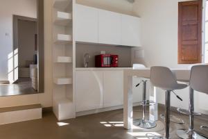 Cucina o angolo cottura di Palazzo dei Ciompi Suites
