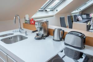 A kitchen or kitchenette at LUXURY CENTRAL DUPLEX WITH TERRACE