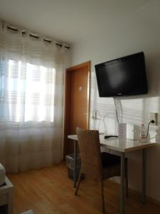 A television and/or entertainment center at Arkadia Hotel
