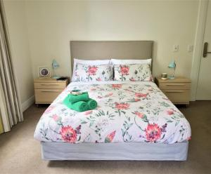 A bed or beds in a room at The Marion Hostel