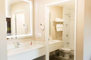 A bathroom at Super 8 by Wyndham Wickenburg AZ