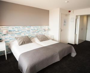 Un ou plusieurs lits dans un hébergement de l'établissement Strandhotel Het Hoge Duin