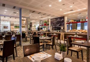 A restaurant or other place to eat at Astral Maris Hotel