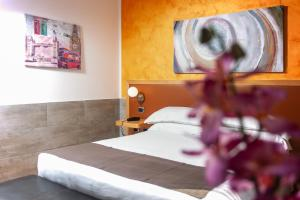 A bed or beds in a room at ibis Styles Roma Vintage