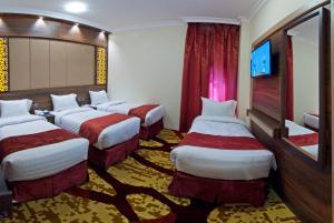 Cama ou camas em um quarto em فندق ديار السلام