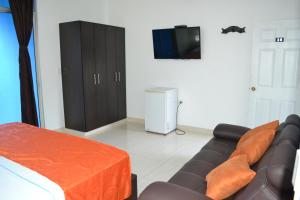 A television and/or entertainment center at Hotel la Colina