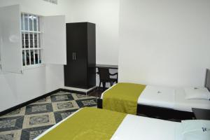 A bed or beds in a room at Hotel la Colina