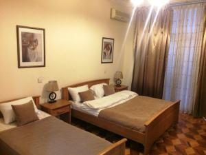 Cama ou camas em um quarto em Nizami Street Apartment 66
