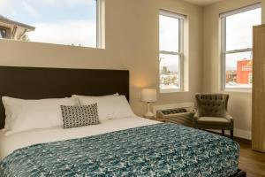 A bed or beds in a room at Lake Placid Inn: Main Street